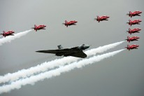 The Red Arrows fly in formation alongsid